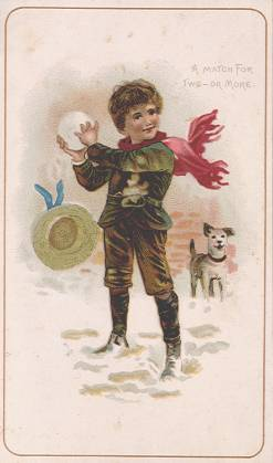 Boy with giant snowball and dog
